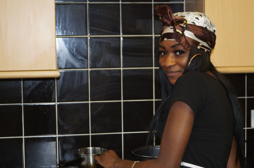 young black lady cooking