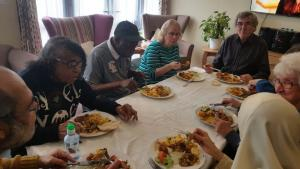 Matthew Court - Retirement Scheme having Asian dinner prepared by residents